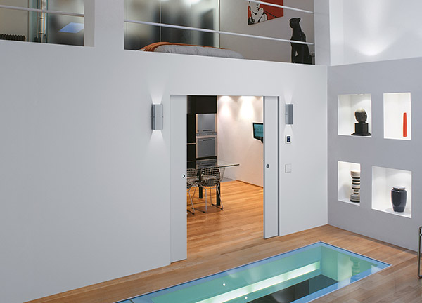 ECLISSE wiring-ready sliding pocket door system with no jambs nor architraves
